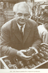 Mads Clausen holding a compressor in 1951